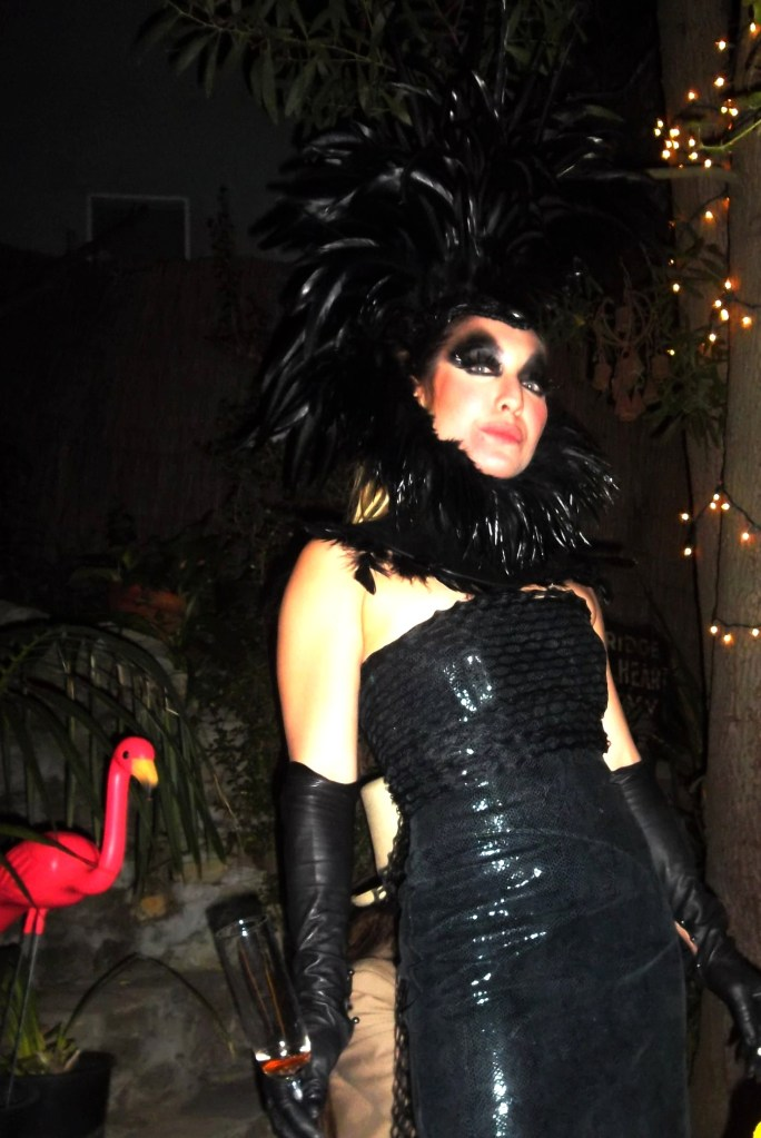 Host Ariel Sands in a stunning feather headdress