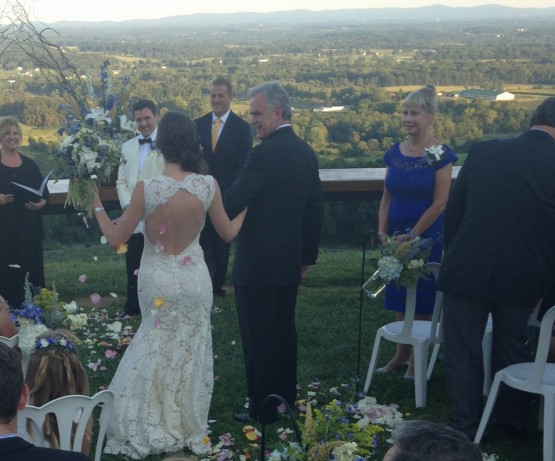 the couple is treated to cheers even before the ceremony begins