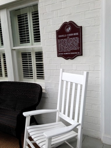 A plaque marks the home's historic status.
