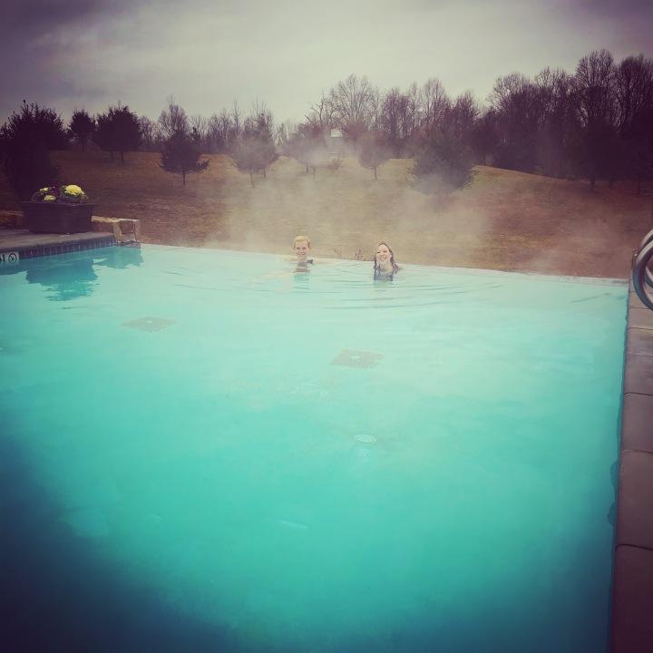 girls in a heated pool